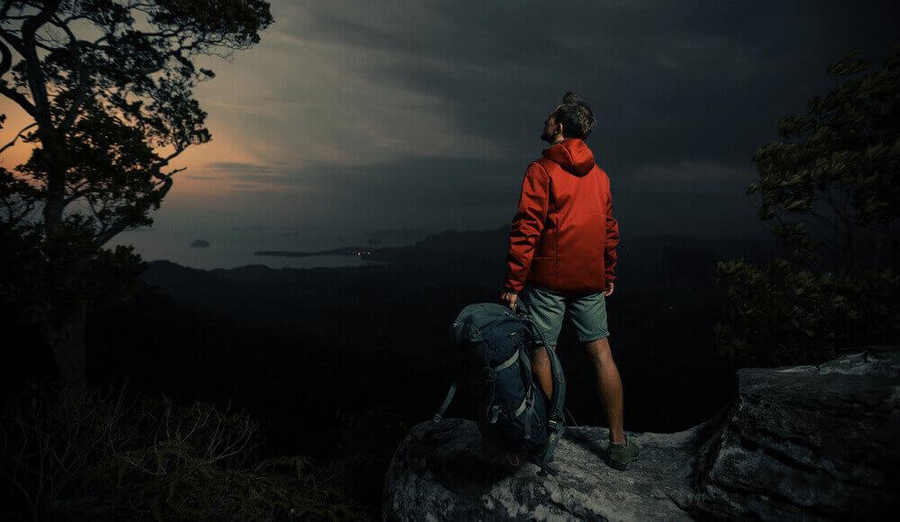 Man hiking at night.