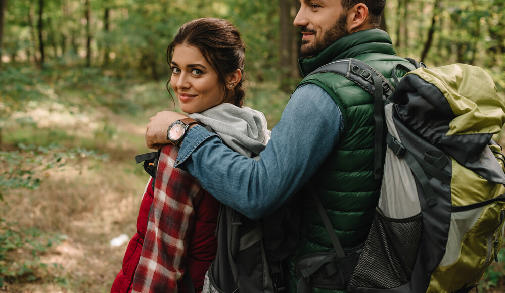 Girl with makeup on when hiking with boyfriend.